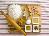 Overhead view of cake ingredient on kitchen worktop with rolling — Stock Photo
