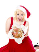 Portrait of a happy young woman holding christmas cookies — Stock Photo