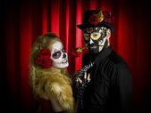 Portrait of a scary couple over red background — Stock Photo