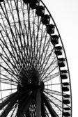 Silhouette image of ferris wheel at amusement park — Stock Photo