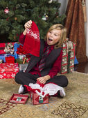 Surprised blonde boy with his christmas gift — Stock Photo