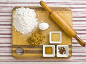 Top view of cake ingredient and rolling pin on kitchen worktop — Stock Photo