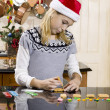 View of a girl making gingerbread house — Stock Photo