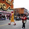 View of a tall man in clowns costume performing on road — Stock Photo #19350157