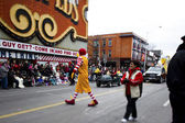 View of a tall man in clowns costume performing on road — Stock Photo
