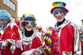 View of man and woman in clowns costume and face paint — Photo