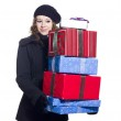 Beautiful young woman holding a stack of christmas presents — Stock Photo #19433549