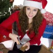 Beautiful young lady cutting credit cards with a scissor — Stock Photo #19433513