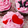 Close up top view of three decorated pink cupcakes — Stock Photo