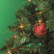 Cropped image of christmas tree with a ball — Stock Photo #19434677
