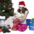 Happy young female opening her christmas present — Stock Photo