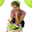 Stock Photo: Happy young woman holding a cupcake
