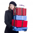 Stock Photo: Beautiful young woman holding a stack of christmas presents
