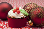 Cupcake with baubles — Stock Photo