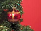 Christmas balls over the christmas tree — Stock Photo