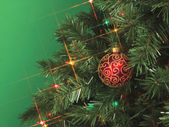 Cropped image of christmas tree with a ball — Stock Photo