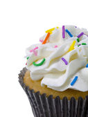 Cropped image of cupcake with sprinkle — Stock Photo