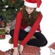 Lady wrapping a gift — Stock Photo