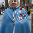 Portrait of a senior woman with medals — Stock Photo