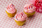 High angle view of strawberry cupcake with sugar icing — Stock Photo