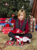Portrait of a boy with his christmas present — Stock Photo