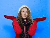 View of a young woman with snow falling on her — Stock Photo