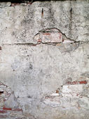 Aged cement wall with brick — Stock Photo