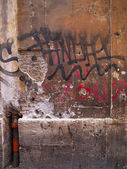 Heavily graffitied wall — Stock Photo