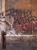 Heavily graffitied wall — Stock Photo