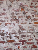 Repaired and restored tuscan brick wall — Stock Photo