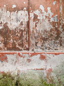 Worn plaster and cement outdoors wall — Stock Photo