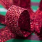 Close up shot of shiny ribbon on christmas gift box — Stock Photo #19482541