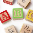 Abc playing cubes arranged over white background — Stock Photo