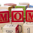 Building blocks forming a word mom — Stock Photo
