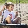 Smiling boy ready for a swing — Stock Photo