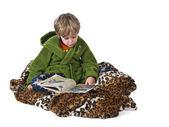 Boy reading comic book before sleeping — Stock Photo