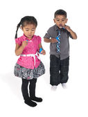 Asian boy and girl playing with bubble wand — Stock Photo