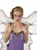 Blond female in fairy costume starring — Stock Photo
