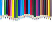 Colored pencil arranged side by side over white — Stock Photo