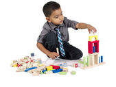 Cute asian boy playing with building blocks — Stock Photo