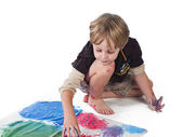 High angle view of a elementary boy doing painting — Stock Photo