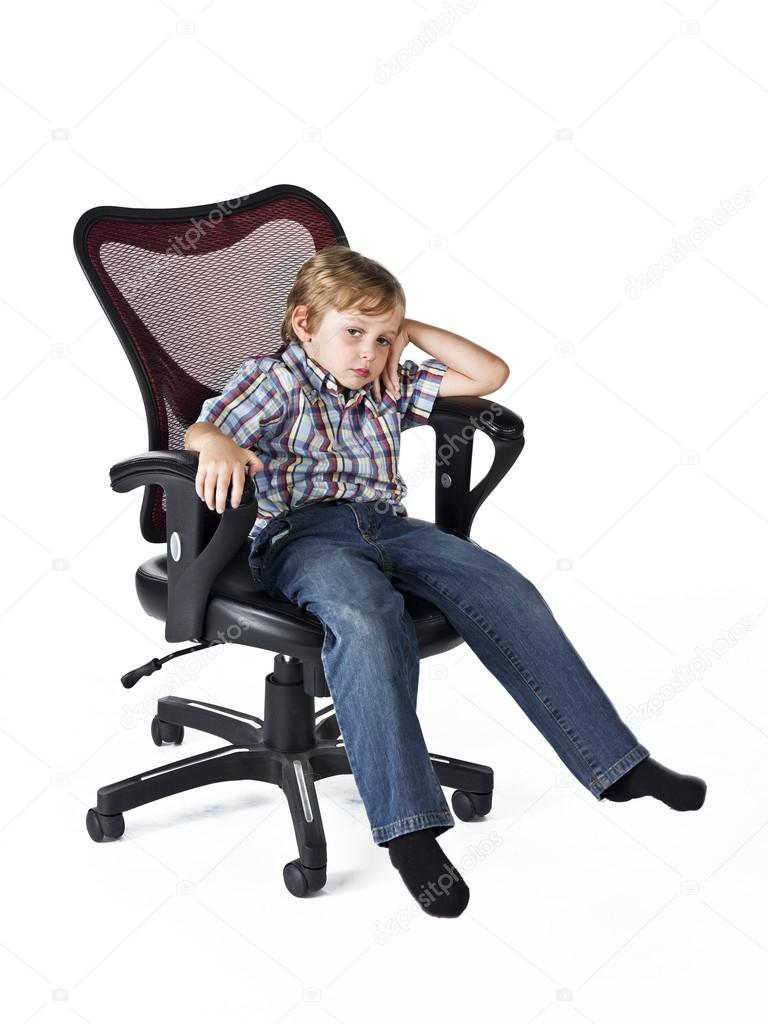 Tired Little Boy Sitting On Chair