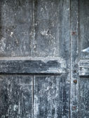 Ancient wood door in tuscany one — Stock Photo