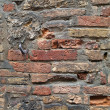 Stock Photo: Pocked brick wall