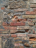 Pocked brick wall — Stock Photo