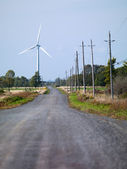100 road with wind mill in the background — Stock Photo