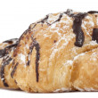 Постер, плакат: Cropped image of chocolate croissant