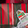 Stock Photo: Snowman sticker on christmas gift box