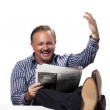 302 mature businessman gesturing while reading newspaper — Stock Photo