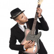 725 young african american businessman playing guitar — Stock Photo